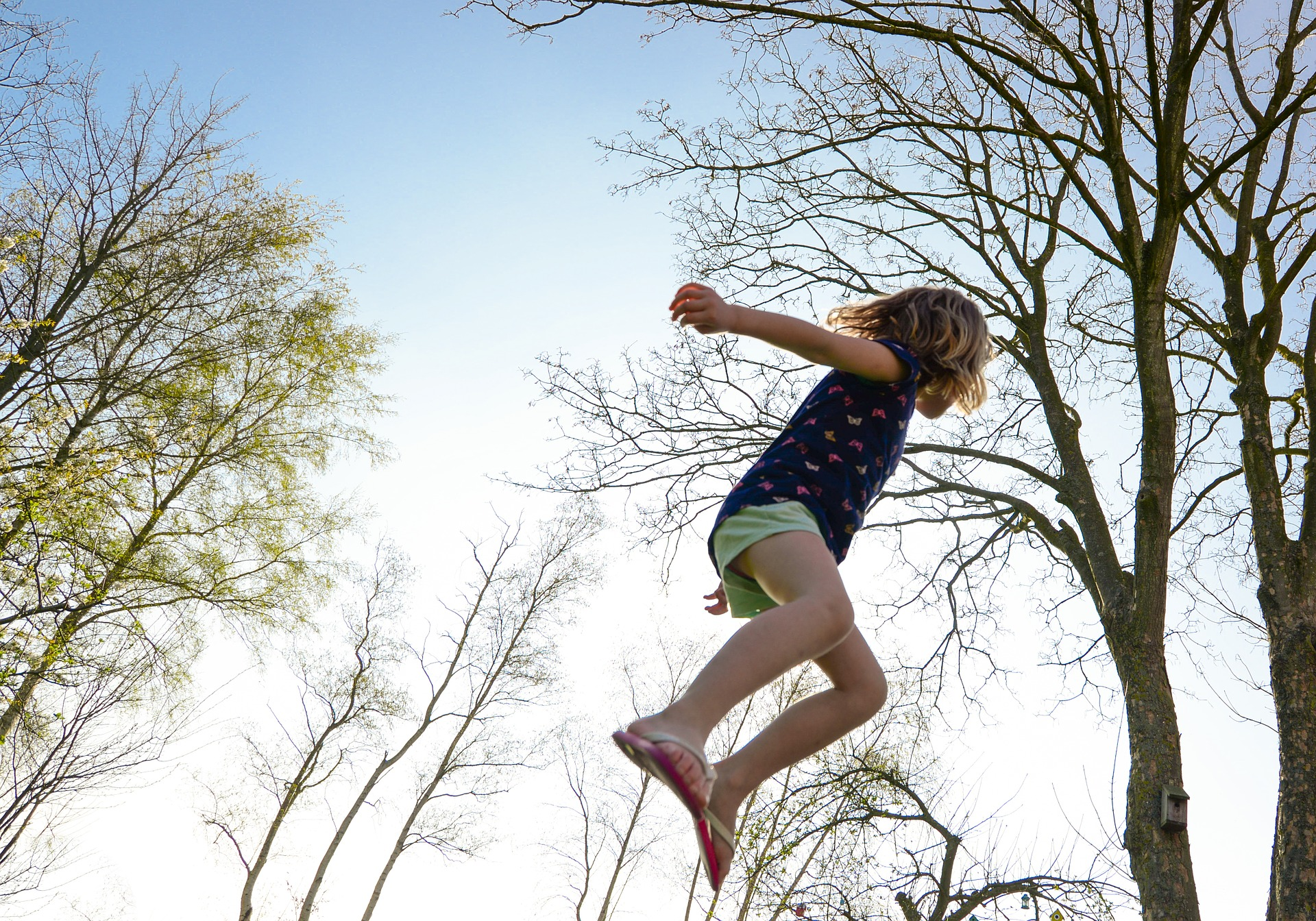 girls jumping on trampoline to improve her mental wellbeing with exercise